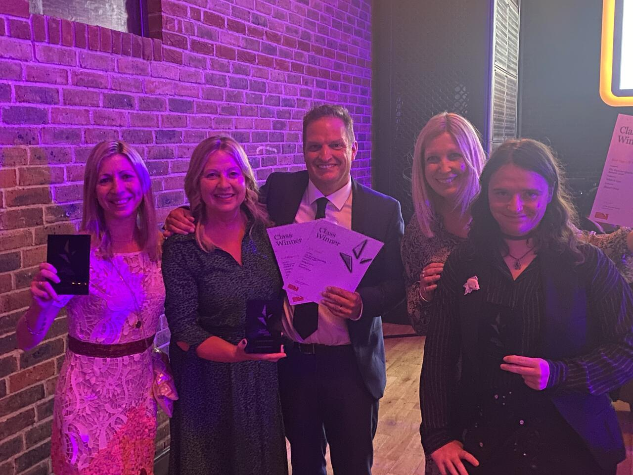 A group photo of the Sequel Group team celebrating award winning project at IoIC Awards 2021-3