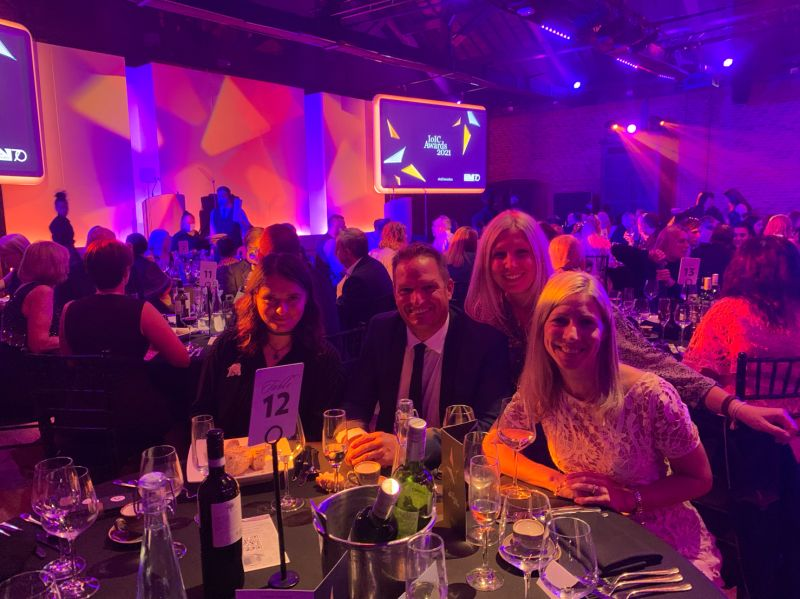 A group photo of the Sequel Group team celebrating award winning project at IoIC Awards 2021